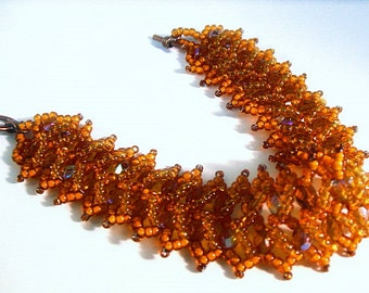 Crystal bracelet woven in rust bronze and light gold crystals