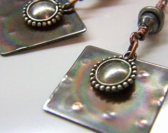 Mixed metal earrings, embossed copper and sterling silver