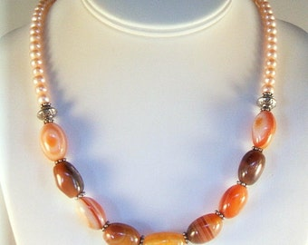 Ivory pearl necklace with orange rust and brown sardonyx beads