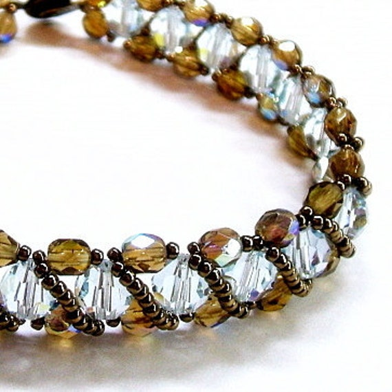 Ice blue bracelet woven with bronze crystals