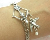 The Hunger Games Inspired Katniss arrow- -----Pretty retro silver  bird with bow pearl pendand hand chain