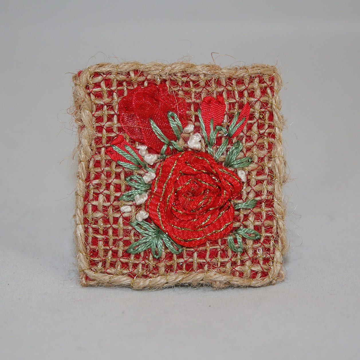 Embroidered brooch red roses on hessian