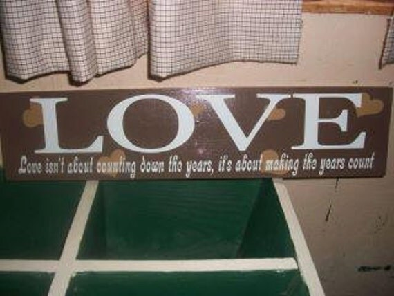 Love isnt about counting down the years its about making the years count. Wooden Home Decor Sign 24x6