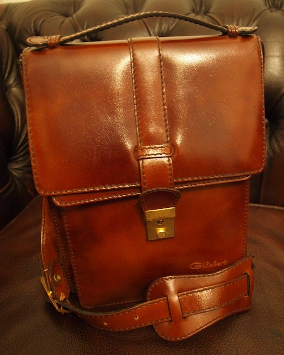 Vintage leather bag with lock and key. Original tags. French messenger bag. Made by Gilabert. Rich conker brown leather.