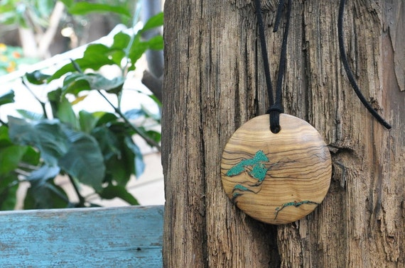 Pendant of malachite and olivewood