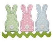 Personalized, appliqued three Easter bunnies with ric rac tshirt or onesie.