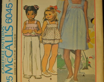 Girls' Dress or Jumper or Top and Panties with Blue Transfer for Embroidery Size 10 Uncut Vintage 1970s Sewing Pattern-McCall's 6045