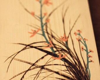 Wood burning of kaffir lily