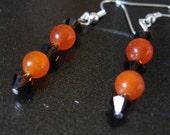 Deep Orange Smooth Bead Earrings with Dark Brown Swarovski Crystals