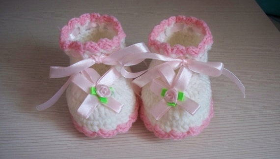 Baby booties with little pink silk ribbon flower