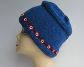Knit royal blue pillbox hat with red and blue buttons