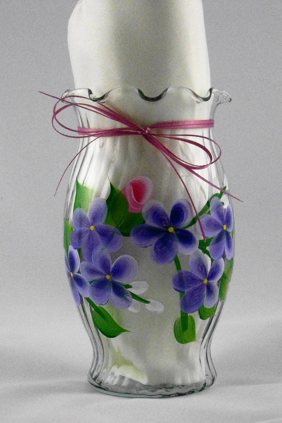 Vase with roses and violets