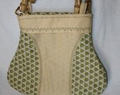 green and black circles on a white background and yellow/white checkerboard retro purse with bamboo handles