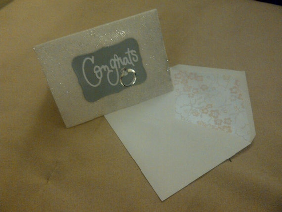 She said I Do. Say, Congrats with this blinging engagement card.