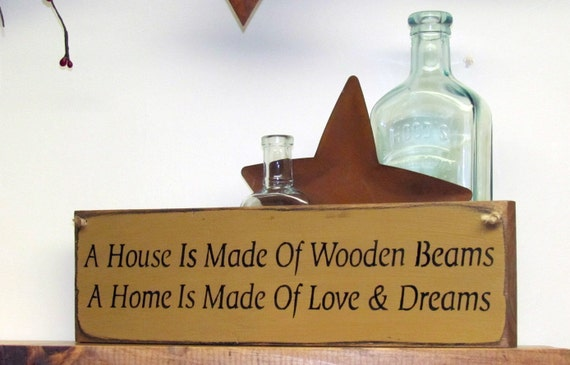 Wooden house sign a house is made of wooden beams a by - Wooden door signs for home ...