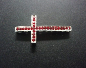 Silver sideways cross w/ red rhinestones