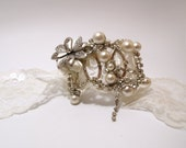 Bridal cuff bracelet with ivory lace, bead pearls and crystals  by Josefine's bijouterie Bridal collection