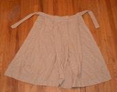 Knee lenth woman's apron.