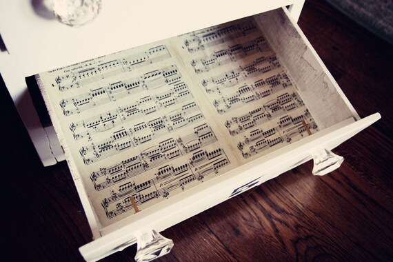Vintage shabby dresser painted white with sheet music liners and crystal knobs