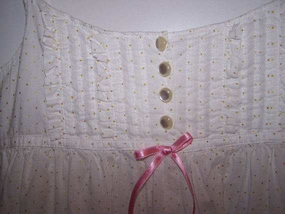 Gap white with gold polks dots...... girls sundress.....size 10....