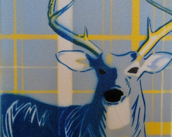Spray paint stencil of deer on canvas