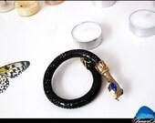 Unusual vintage snake bracelet from the 90s. Black, golden, blue.