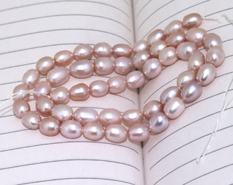 One Full Strand--- Rice Lavender Pure Freshwater Pearl----6-8mm----about  54 Pieces----15 inch strand