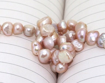 One Full Strand--- Lavender  Flat Pure Freshwater Pearl----5-7mm----about 52 Pieces----14.5 inch strand