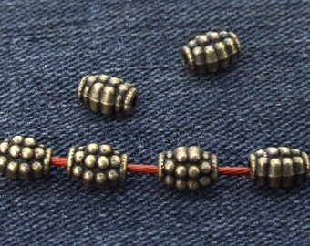 40 pcs of charm dot Oval antique Brass bronze  plated  beads metal findings Beads ----5mmx8mm ----- 40Pieces 2AB