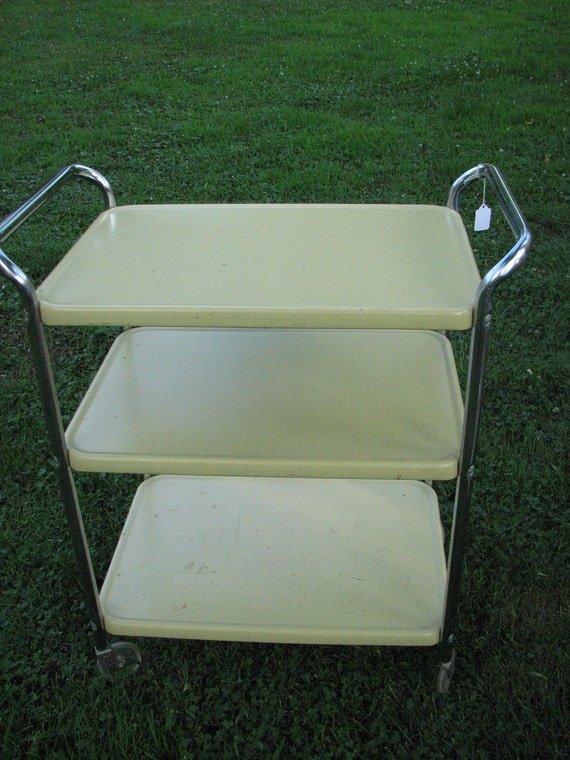 reserved cosco vintage kitchen cart in yellow