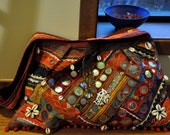 Embroidery bag with vintage tribal fabric, mirrors, shells and coins appliques