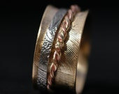 Family's Spinning Ring in New Gold with Line & Floral Pattern