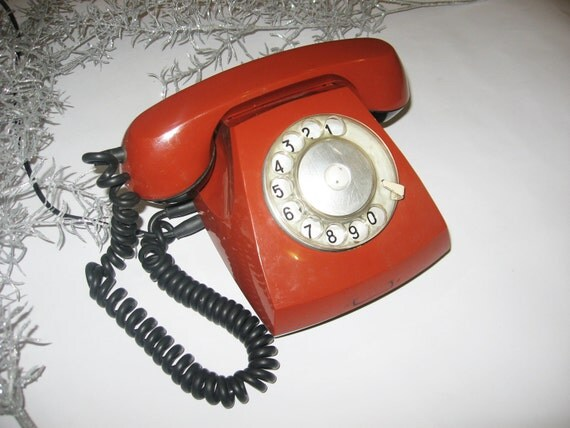 Vintage Russian Soviet rotary phone, retro phone with a rotary drive for a set of  terracotta color