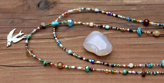 Turquoise and Tigers Eye Double Strand Necklace with Bird Pendant and a Sterling Silver Hoop and Bar Clasp