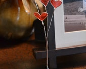 Wire Stand of Red Heart Balloons