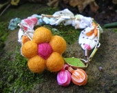 SALE- A Cheery Thought bracelet- vintage flowers. orange. bright pink. felted flower. vintage brass chain. colorful.  Jettabugjewelry