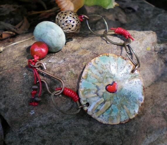 Heart Strings bracelet- turquoise ceramic bead focal, heart pendant, red leather, brass, Southwest glam. Jettabugjewelry