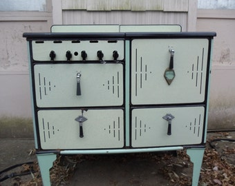 1920 enamel gas stove,  green  and cream with black bakelite handles