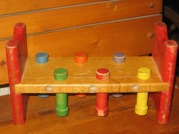 Vintage Wooden Pounding in wooden Peg Bench