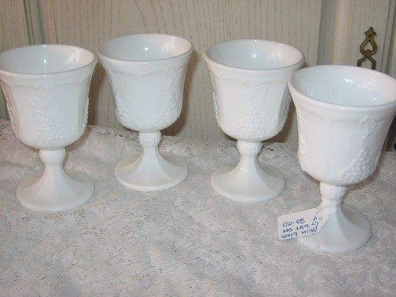 Milk Glass Set of 4 Goblets in good Condition Harvest Grape Pattern.