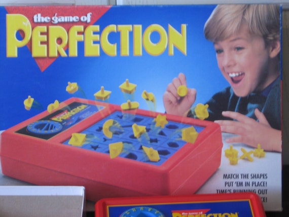 The Game of Perfection Get the Shapes in and Beat the Clock Great For Children with Special needs /