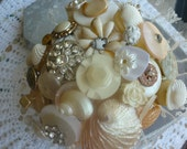 wedding bouquet in shell, pearl, white and cream colours