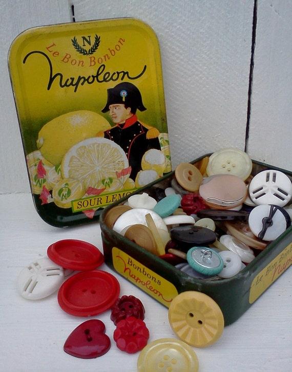 Vintage buttons 1/4 pound buttons in a vintage Le Bonbon Tin
