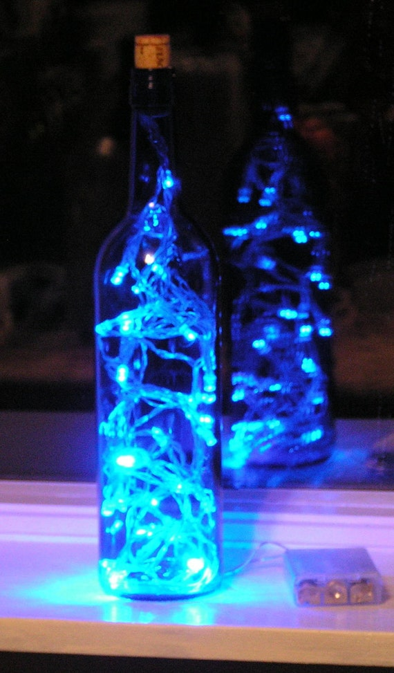Blue glass wine bottle light with blue led lights inside for Glass bottles with lights in them