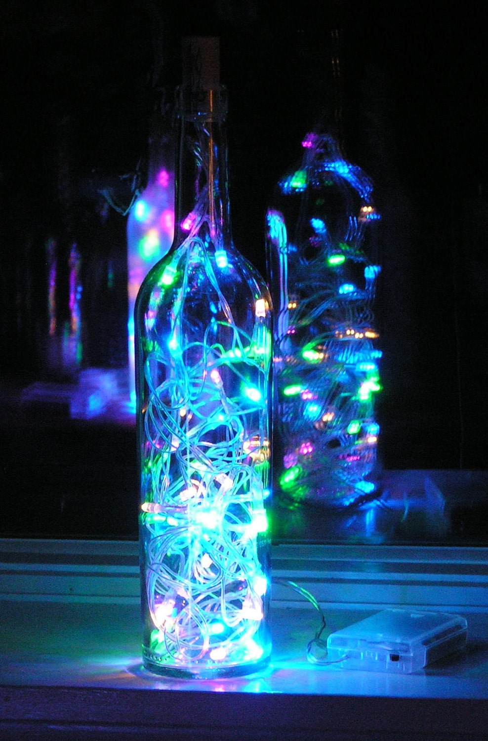 Clear Wine Bottle Light with multi-colored pastel LED lights