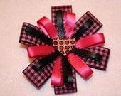Pink and black pinwheel ribbon bow clip