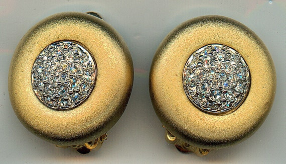 Vintage Swarovski Earrings.  Gold Tone Circles with a Central Crystal Cluster, Clip On, Signed.