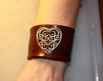 wide leather cuff with heart and scroll work engraving