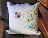 A Ladybug, Mushrooms and Fern Appliqued and Quilted Cushion Cover