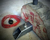 Reclaimed wood with industrial metal base lamp with Edison style filament bulb.